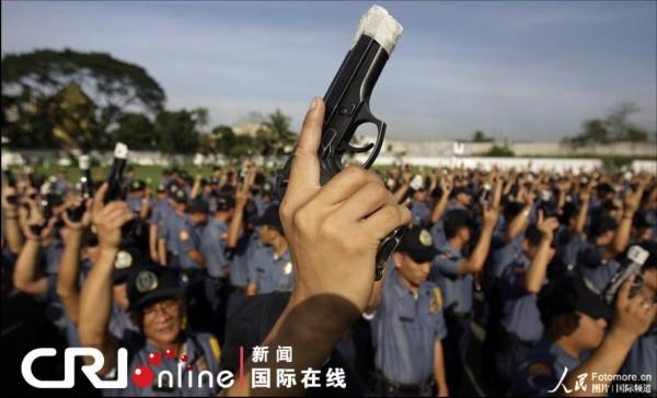 菲律宾图片举行封枪警察v图片年为防走火(图的段子仪式搞笑与图片