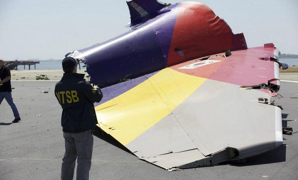 韩亚遇难者照片_韩亚航空坠毁客机内部照片曝光_新闻_南海网