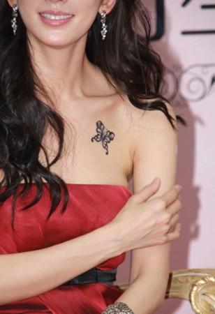 林志玲半裸香肩秀蝴蝶纹身 细数明星纹身背后那些事