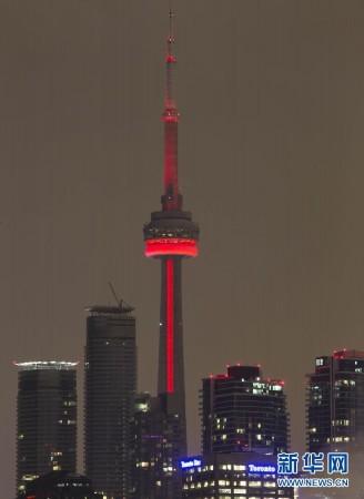 加拿大地标国家电视塔以一袭中国红点亮最大城市多伦