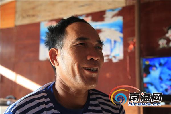 永興島上的漁民韋昌清談起未來生活時露出了笑容。