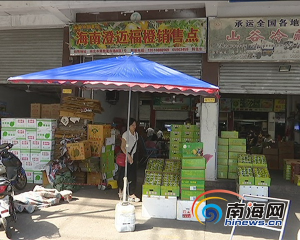 海口一家水果市场部分商家未经授权售琼中绿橙 将整改