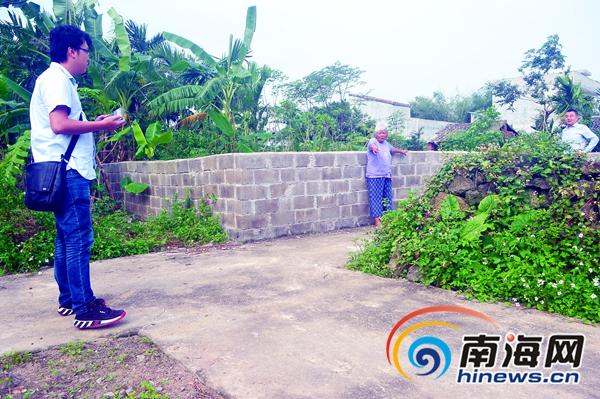海口秀英被免村支书砌墙堵路 被判拆除后加建3道围墙