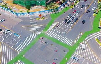 亮眼!绿色非机动专用车道亮相琼海嘉积街头