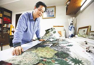 海南本土画家邓子芳把海南山水画进人民大会堂